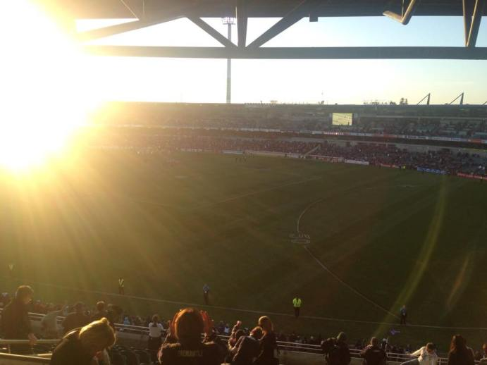 Sun sets over domain stadium.