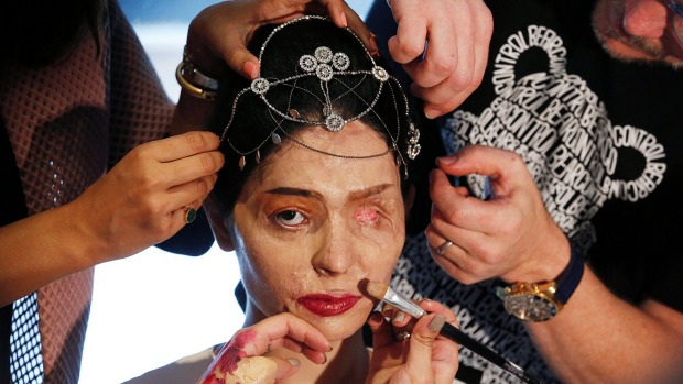 Acid burn victim Reshima Qureshi prepares to walk the runway