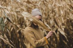 woman-hides-behind-dry-harvest-leaves_4460x4460_aa43e9c4d2-6d46-4657-94f6-677830d88a87_medium